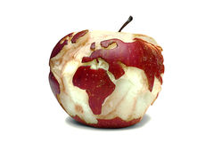 World map on an apple. Red apple with a map of the world cut into it, over a white background Royalty Free Stock Photo