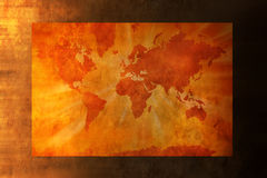 World Map Background. A warm toned world map on a textured background with two layers Royalty Free Stock Photography