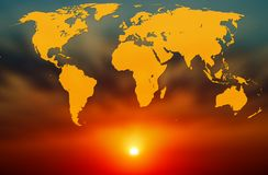 World map on the background of blurred sunset royalty free stock image