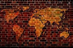 World map on the background of a brick wall. Stock Images