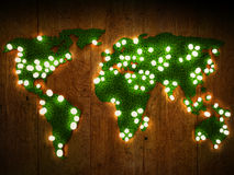World map background with grass field and wood with glowing lights. Royalty Free Stock Images