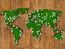 World map background with grass field and wood with lights. Stock Images