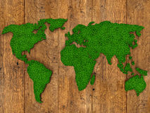 World map background with grass field and wood texture Royalty Free Stock Photography