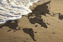 World map on beach Stock Photos