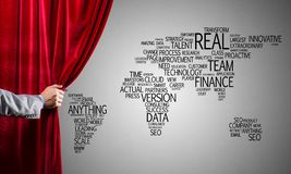 World map behind drapery curtain and hand opening it stock photography