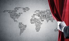 World map behind drapery curtain and hand opening it. Close up of hand in white glove open red velvet curtain royalty free stock photos