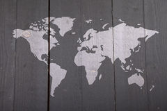 World map on black wooden background Royalty Free Stock Photos
