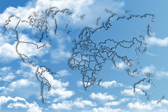 World map on blue sky with fluffy clouds Royalty Free Stock Images