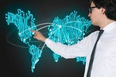 World map. Businessman presses virtual world map on screen Stock Image