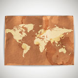 The world map on cardboard grunge background Stock Image