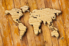 World map carving on wood plank Stock Photos