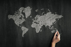World map chalk drawing on a blackboard Royalty Free Stock Images