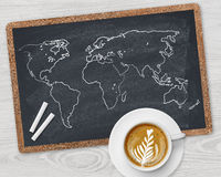 World map and coffee cup Royalty Free Stock Images