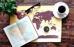 World map with coffee on wooden table top view Royalty Free Stock Photos