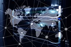 World map with communication network on server room background.  stock photography