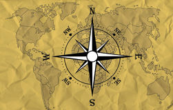 World map with compass. Compass with a world map in the background Royalty Free Stock Image