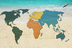 World map and compass on sea background Royalty Free Stock Photos