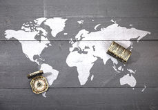 World map with compass and treasure on black wooden background Stock Image