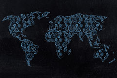 World map with continents made of gearwheels. Concept of globalization mechanisms or worldwide industries Stock Images