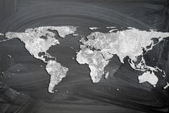 World map. From a cracked stone wall on the blackboard background grunge style royalty free stock images