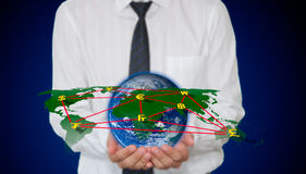 World map and currency network in hand Royalty Free Stock Photos