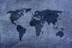 World map on denim jeans background Royalty Free Stock Photos