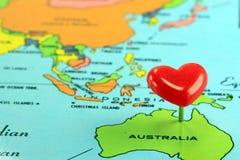 World Map With Destination Pin Australia. Closeup of colorful world map with red destination pin for Australia Stock Photo