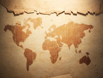 World map displayed on the corrugated old paper Stock Photos