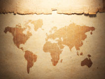 World map displayed on the corrugated old paper Stock Photography
