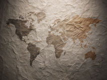 World map displayed on the corrugated old paper Stock Photo