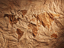 World map displayed on the corrugated old paper Royalty Free Stock Photos