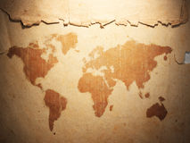 World map displayed on the corrugated old paper Royalty Free Stock Image