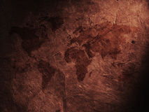 World map displayed on the corrugated old paper Royalty Free Stock Images