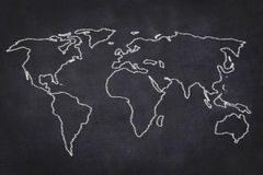 World map drawing on black chalkboard Stock Image