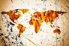 World map and fire flames. Conceptual image of flat world map and fire flames. NASA flat world map image used to furnish this image royalty free stock photos