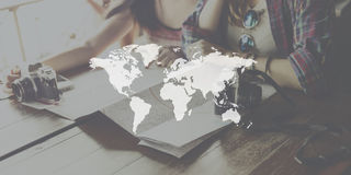 World Map Globalization Cartography Global Planet Concept. Teen girls checking world map globalization cartography global planet Stock Photography
