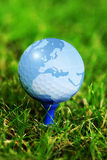 World map on golf ball Stock Image