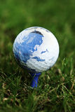 World map on golf ball Stock Image