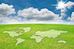 World map on grass field. royalty free stock photography