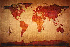 World Map Grunge Styled. World Map on old grungy antique and yellow cracked paper background (Map derived from http://visibleearth.nasa.gov Stock Image