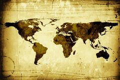 The world map grungy. The world map brown grungy background with scratches marks and spills Stock Photos