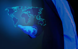 World map on hand businessman, hologram Stock Image