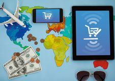 World map holidays with Tablet and phone with Shopping trolley icon. Digital composite of World map holidays with Tablet and phone with Shopping trolley icon Royalty Free Stock Photos