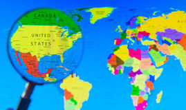 World map. Its a world map and magnifying glass Royalty Free Stock Image