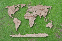 World map Laterite on green moss background. Royalty Free Stock Photos