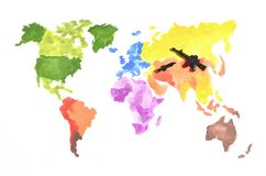 The world map is made with colored watercolor paints on white paper with the participation of a black toy gun and a knife. The con stock photos