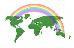World map made with grass and rainbow over Royalty Free Stock Image