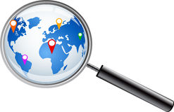 World map with magnifying glass Stock Images