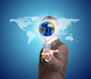 World map and man hold bulb with Earth Stock Image