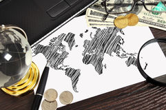 World map and money Stock Photo